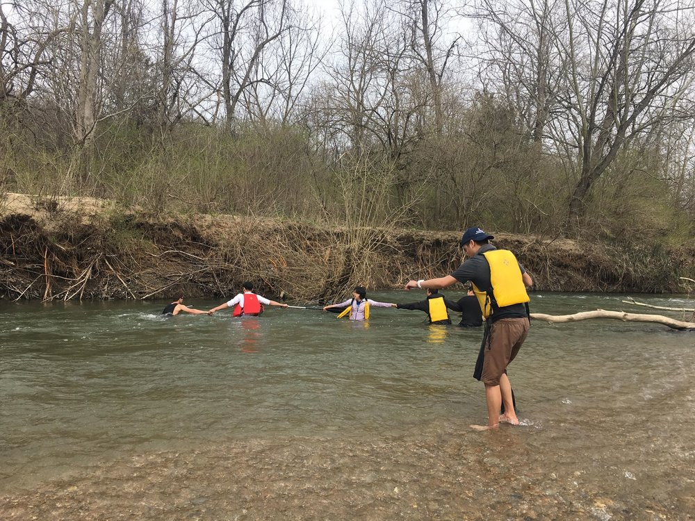 Yaros, Berton, Iris, Jimmy, and Andrew all worked together to retrieve an oar.