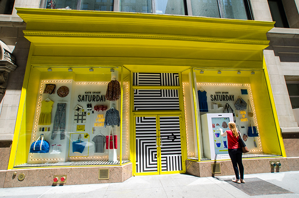 Kate Spade's Saturday Pop-up simplified limited edition retail with window dressing and digital interfaces