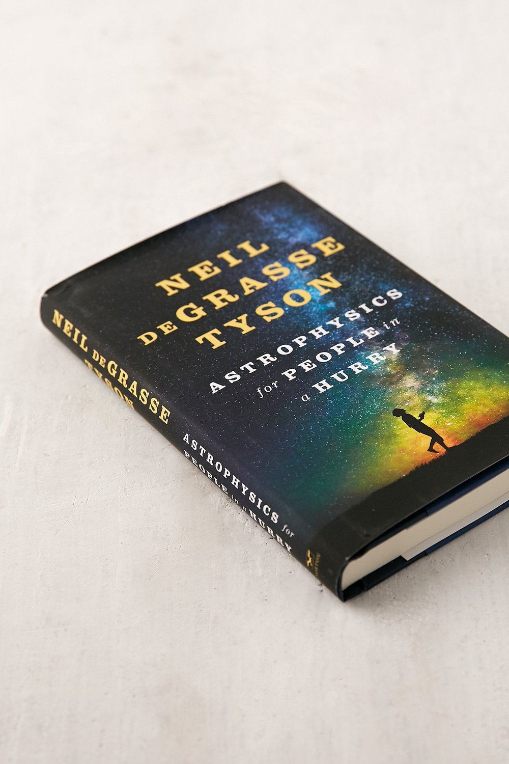 "Currently Reading : Neil deGrasse Tyson's latest ""The universe is under no obligation to make sense to you."""