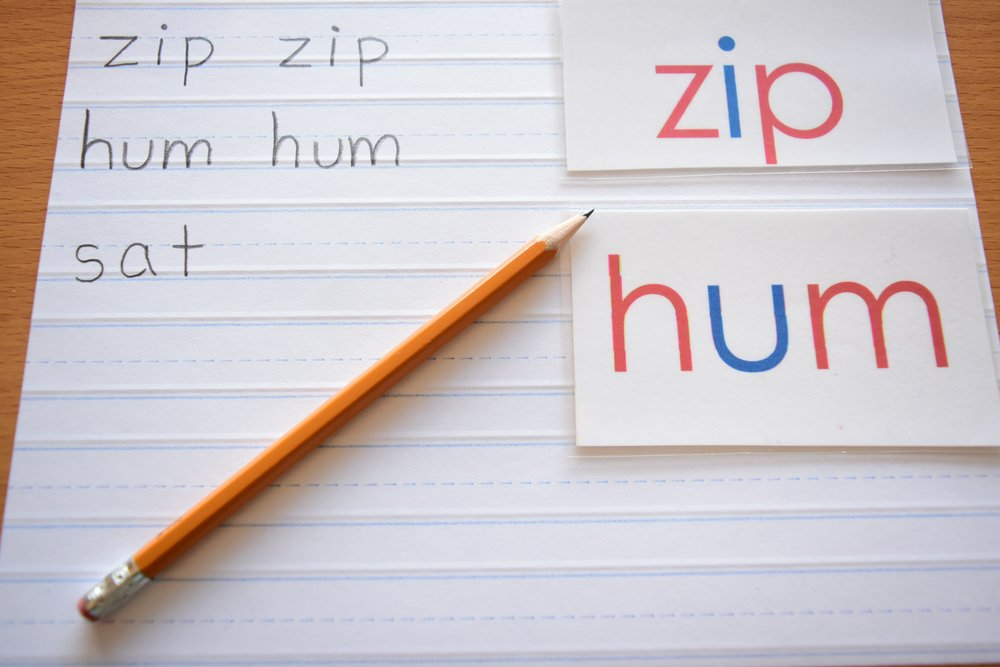 How we teach handwriting in Montessori, a child's writing paper