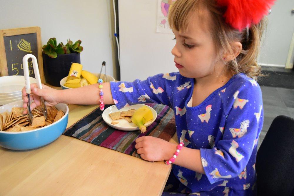 Child serving snack.