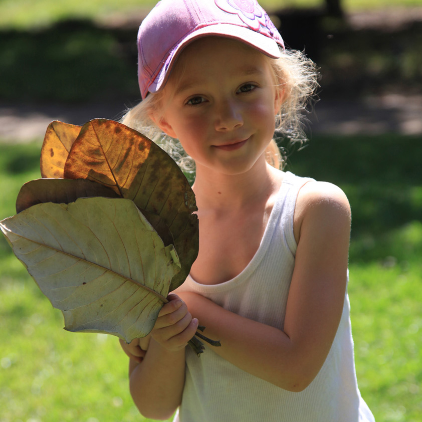 Child holding leaves