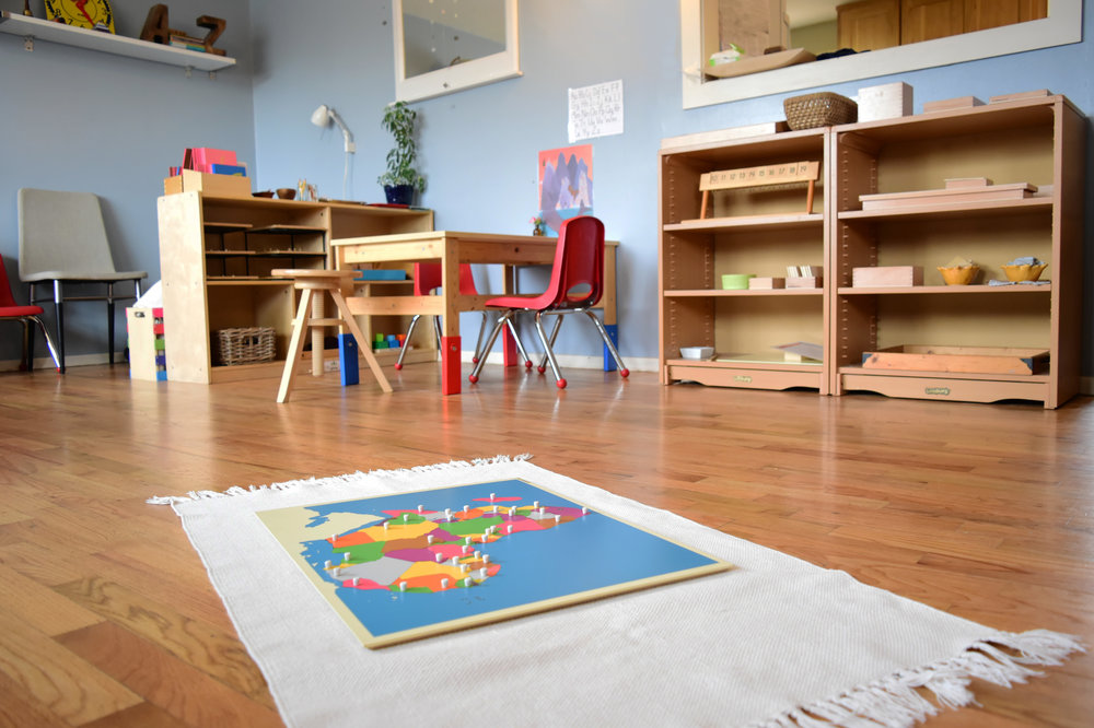 A Montessori classroom complete with adult observation chair
