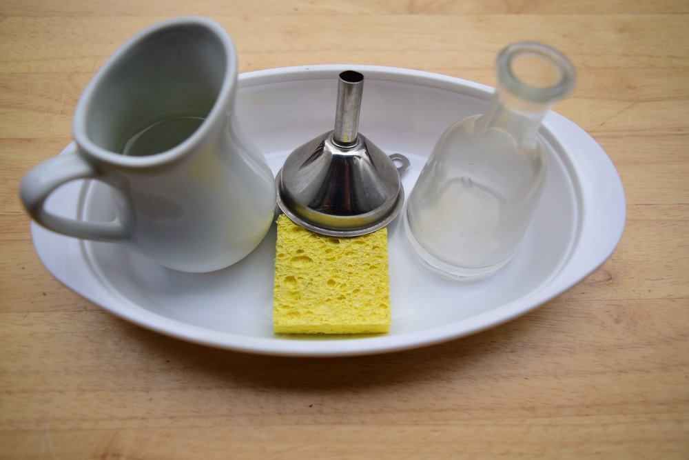 Create a pouring water activity out of household items