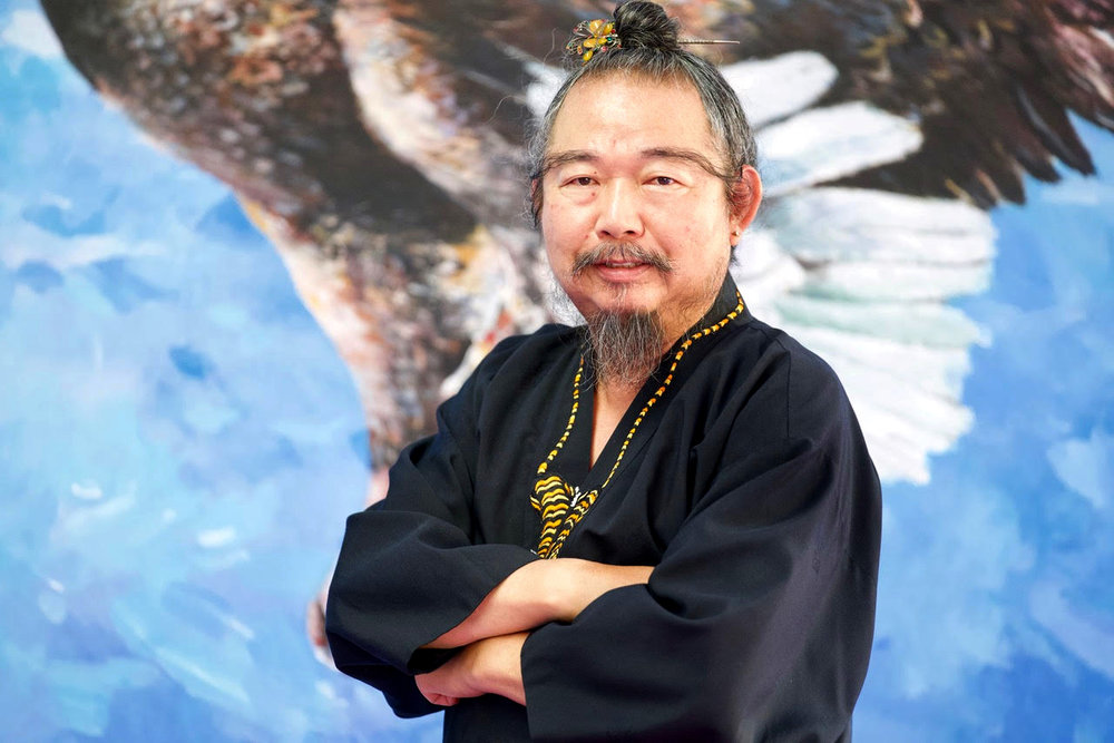 """OUR FOUNDER - Great Grandmaster Yong Moon was born in Hapcheon, South Korea, and began training at an early age as he was born into a martial arts household. He first began training in Tang Soo Do, a very popular style in his region. After many years of practicing Tang Soo Do, he then learned Classical Kung Fu under Master Kang Gum Bang in Busan, South Korea. Master Kang Gum Bang was one of the three Chinese historic masters who emigrated to South Korea during the Communist Revolution in China.After many years of training under the famous, Master Kang Gum Bang, Great Grandmaster Moon decided to start his own school, teaching a hybrid form of both Korean and Chinese martial arts. This fusion of styles is analogous to Bruce Lee's Jeet Kune Do, which Bruce based it off of his previous training in Kung Fu and Wing Chun.Great Grandmaster founded The World Martial Arts Federation ins 1968, and started in Busan, South Korea. In 1979, he immigrated to the United States and started a school in New Orleans, Louisiana. He quickly rose to fame as """"Master Moon"""" in Louisiana, receiving a plethora of media attention through his martial arts. In 1992, Great Grandmaster Moon moved to Los Angeles, California, started a school, and has been in Los Angeles ever since."""