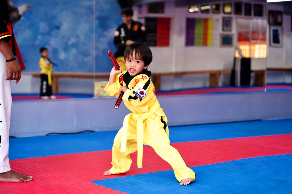"""CULTURE & PHILOSOPHY - We are a family oriented and friendly school, welcoming everyone who wishes to better themselves through martial arts training. We welcome everyone with open arms as long as they are willing to be a positive contributor to our growing martial arts family. We retain a lot of the traditional aspects of martial arts such as bowing, and referring Instructors, Teachers, and Masters with """"sir"""", or """"ma'am"""", while also creating a fun and exciting environment for students to thrive."""