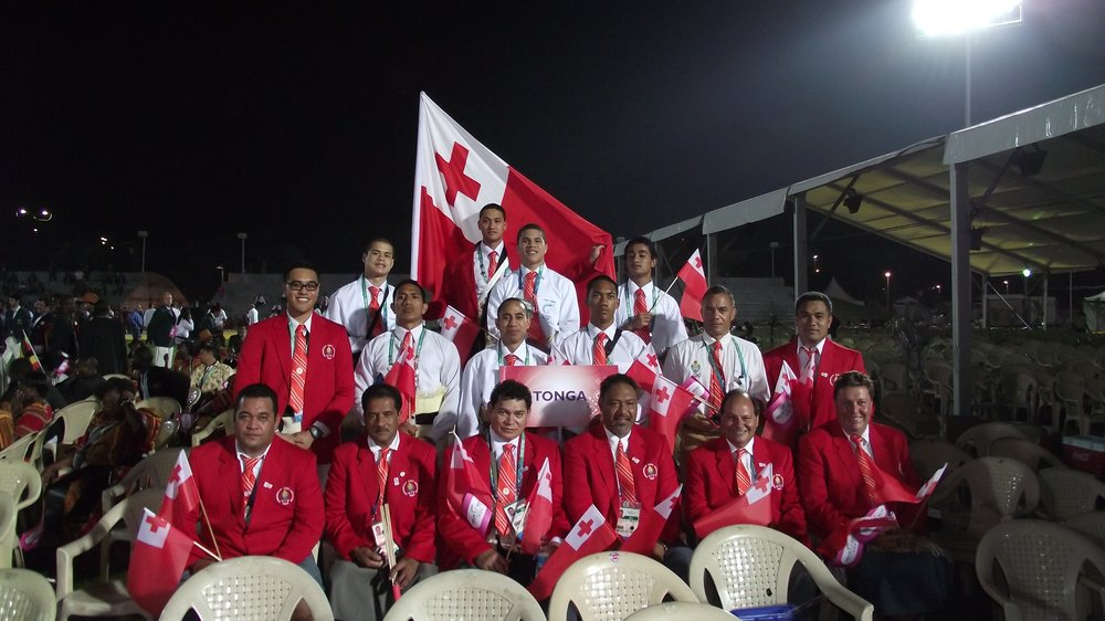 Team Tonga 2010 (minus the Rugby 7s players) at the Opening Ceremony    Notable team members are Bronze medalists – Junior Fa (flagbearer) and Lomalito Moala both boxers plus an International calibre boxing coach Lolo Heimuli (MMA fighter Mark Hunt's coach).