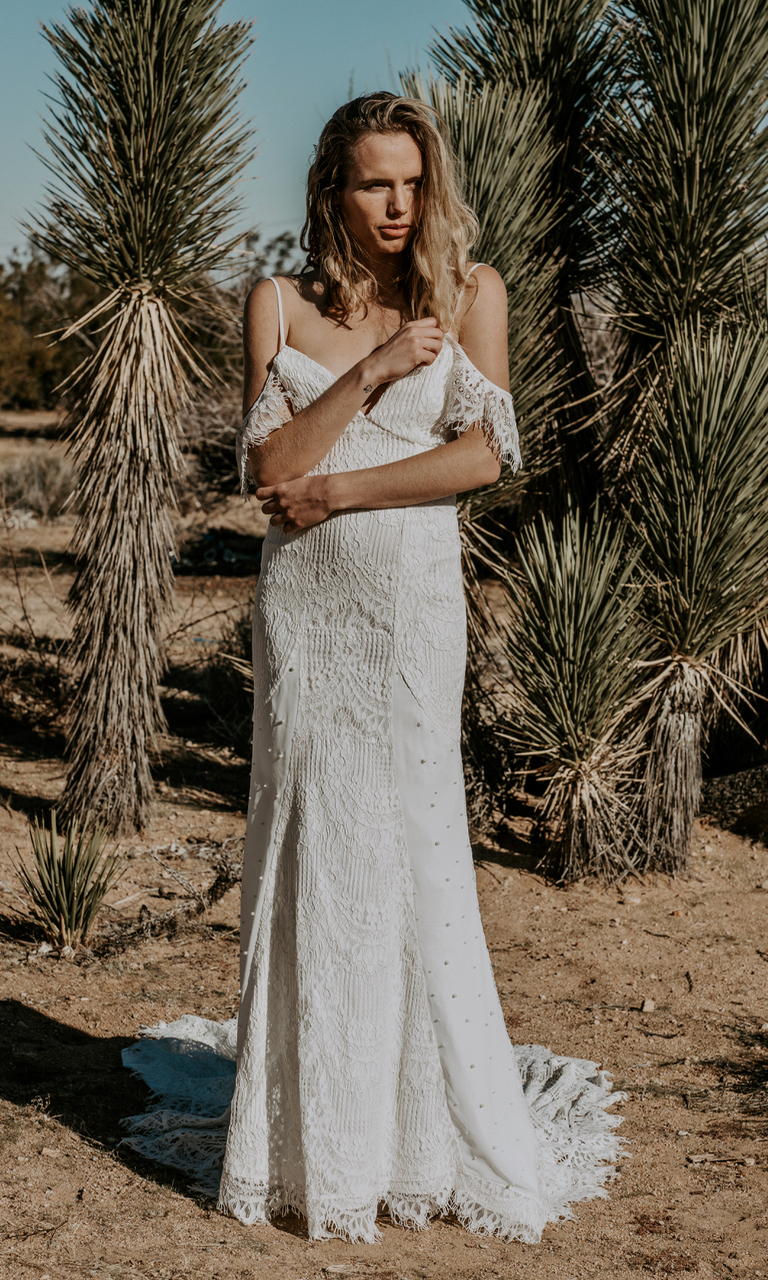 The BADU gown, an off the shoulder dress with some refreshing modern touches. A soft eye-lash crochet lace is combined with pearl beaded chiffon panels along the skirt. See more photos of our brides in the BADU dress below.