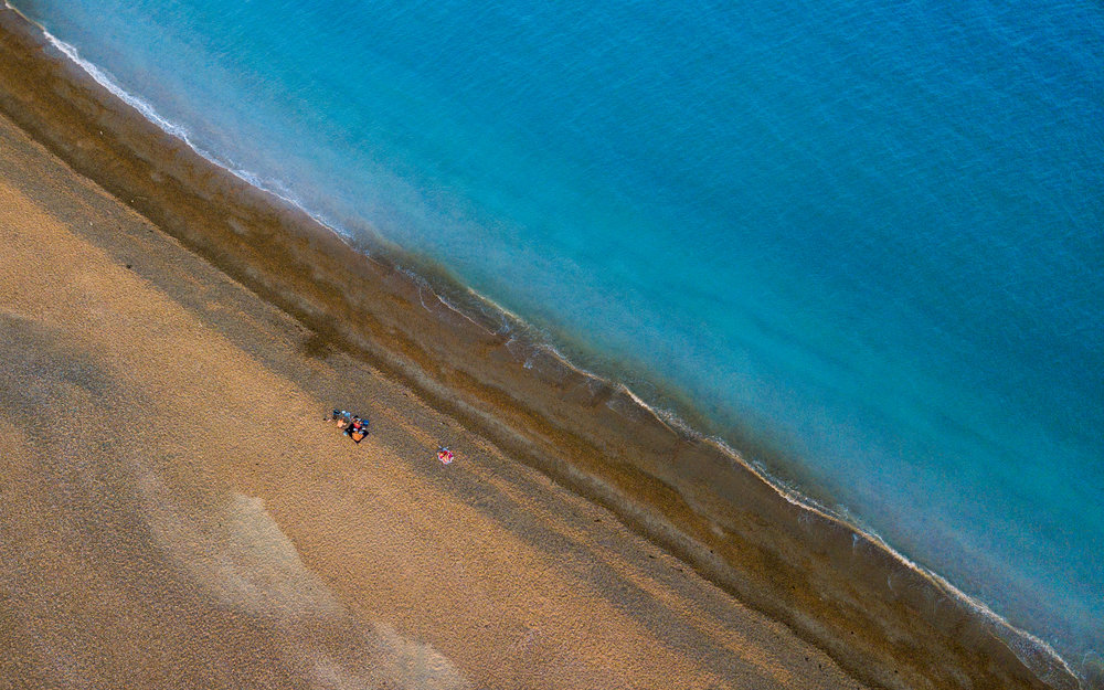 A Kataskopos - Birds Eye View - Top Down Photo of Eastney Beach at Golden Hour