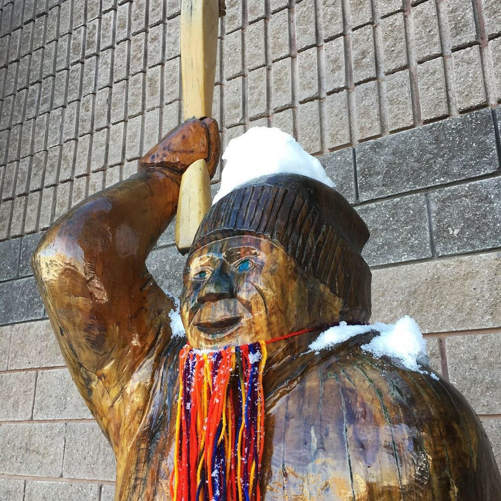"""Honorable Mentions - We made a quick stop in Orangeville, Ontario to beard up some wooden carved statues for the winter season. The statues chosen are """"The Torchbearer"""" by Howard Greenaway, which can be seen in a long rainbow beard. And """"The Boxer"""" by Bobbi Switzer which wears a short, burly black beard."""