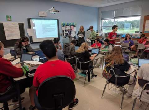 *Photo shared by Putnam County Schools   In the photo:  Prescott South Middle School 8th grade ELA teacher Lacy Means takes her student through a station rotation class exercise using Shmoop test prep. All Putnam County middle schools went through the first year of integrating personalized learning in the classroom in the 2017-2018 school with partner Education Elements and are now in year 2.
