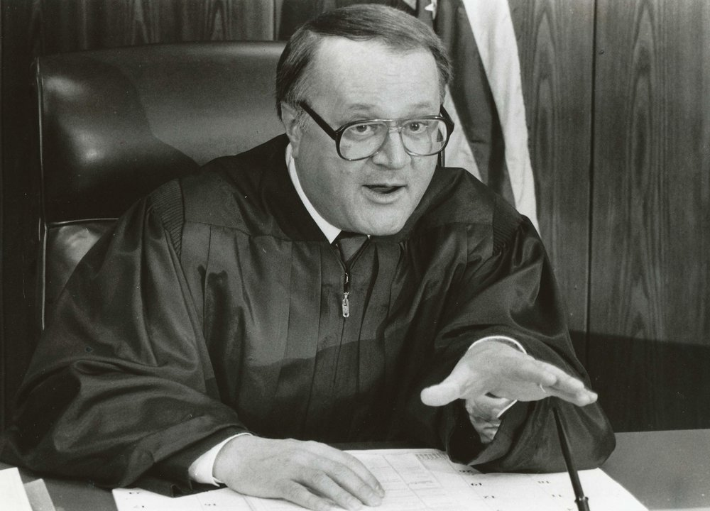 - Judge John Hey presided over John's 1985 trial and set the stage for his convictions. Judge Hey was later convicted of sexual harassment and was known to be intoxicated while on the bench. His errors led to John's first trial being overturned, as he failed to ask the jury about their exposure to reports surrounding the case and allowed the prosecutors to make inappropriate remarks about John in their arguments.