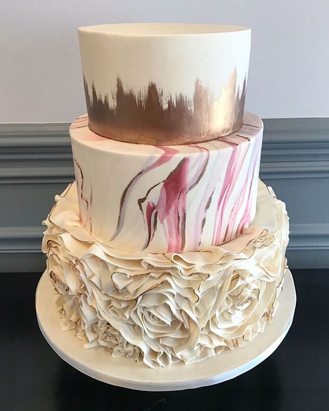 Marbled fondant with floral-inspired ruffles and painted metallic accents #weddingcake #chicagowedding