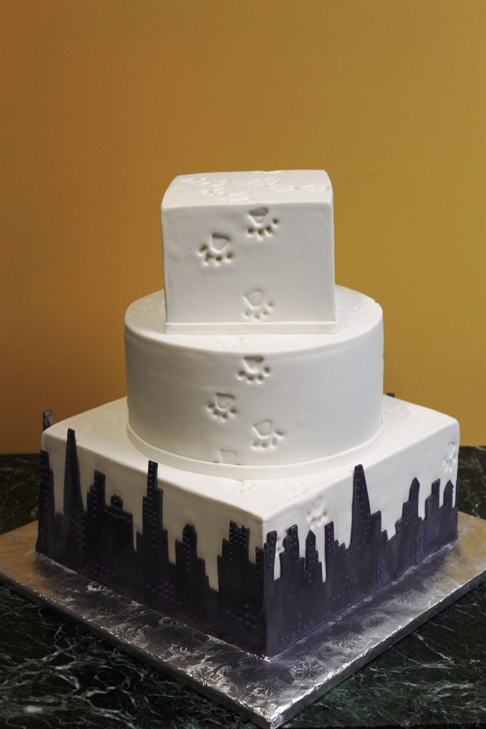 Paw Prints Over Cityscape Wedding Cake