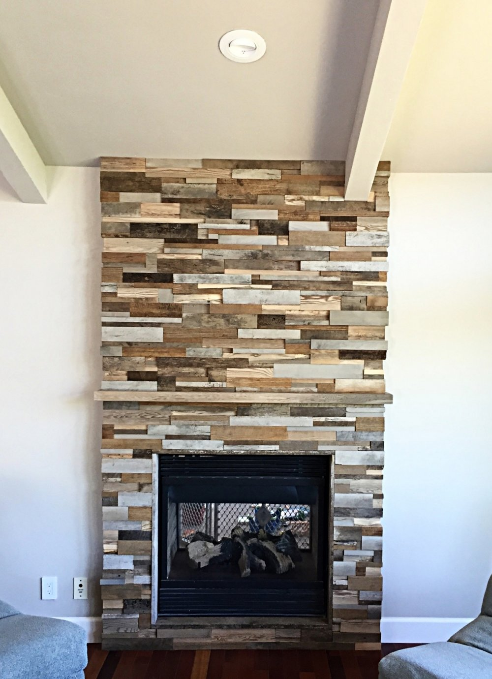 Wood tile fireplace mantle.