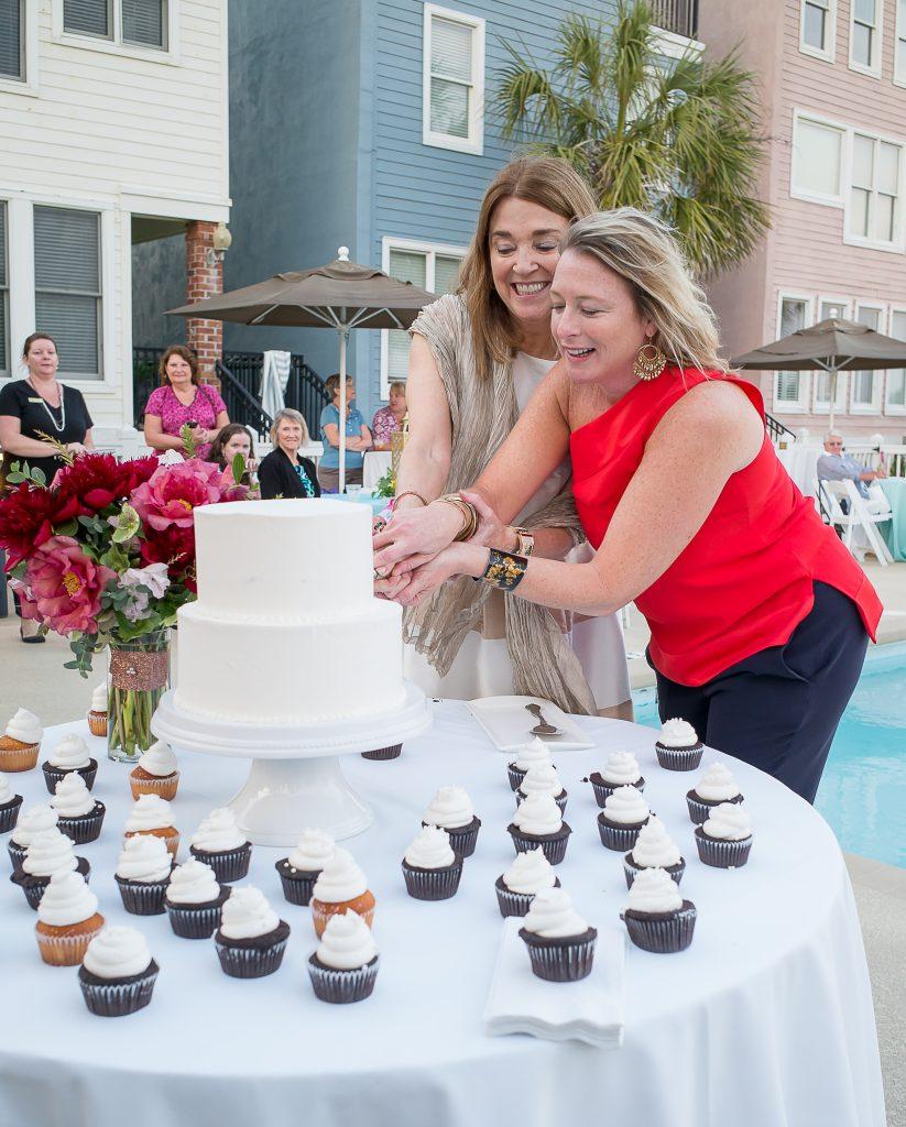 Mary-Alice-Monroe-and-her-editor-Lauren-McKenna-cut-the-wedding-cake-1003334-823x1024.jpg