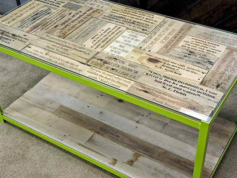 "Cocktail Quotes Coffee Table  Made from pallet wood and steel, this conversation-starting table contains libation-inspired sayings from historical figures. Measures 41""(L) x 20.5""(W) x 20""(H). Angle iron frame available in multiple colors, with clear coat wood finish. Part #: CQCT."