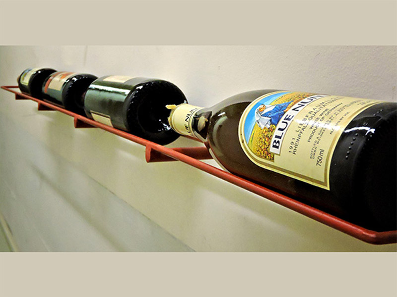 "Wall Mount Wine Rack  Pallets have been redesigned and repurposed into these stylish wine racks. Each rack holds 3-4 bottles of wine and 4 glasses. Measures 15""(L) x 5""(W) x 8.25""(H). Hardware included. Available in multiple colors. Part #: WMWR."