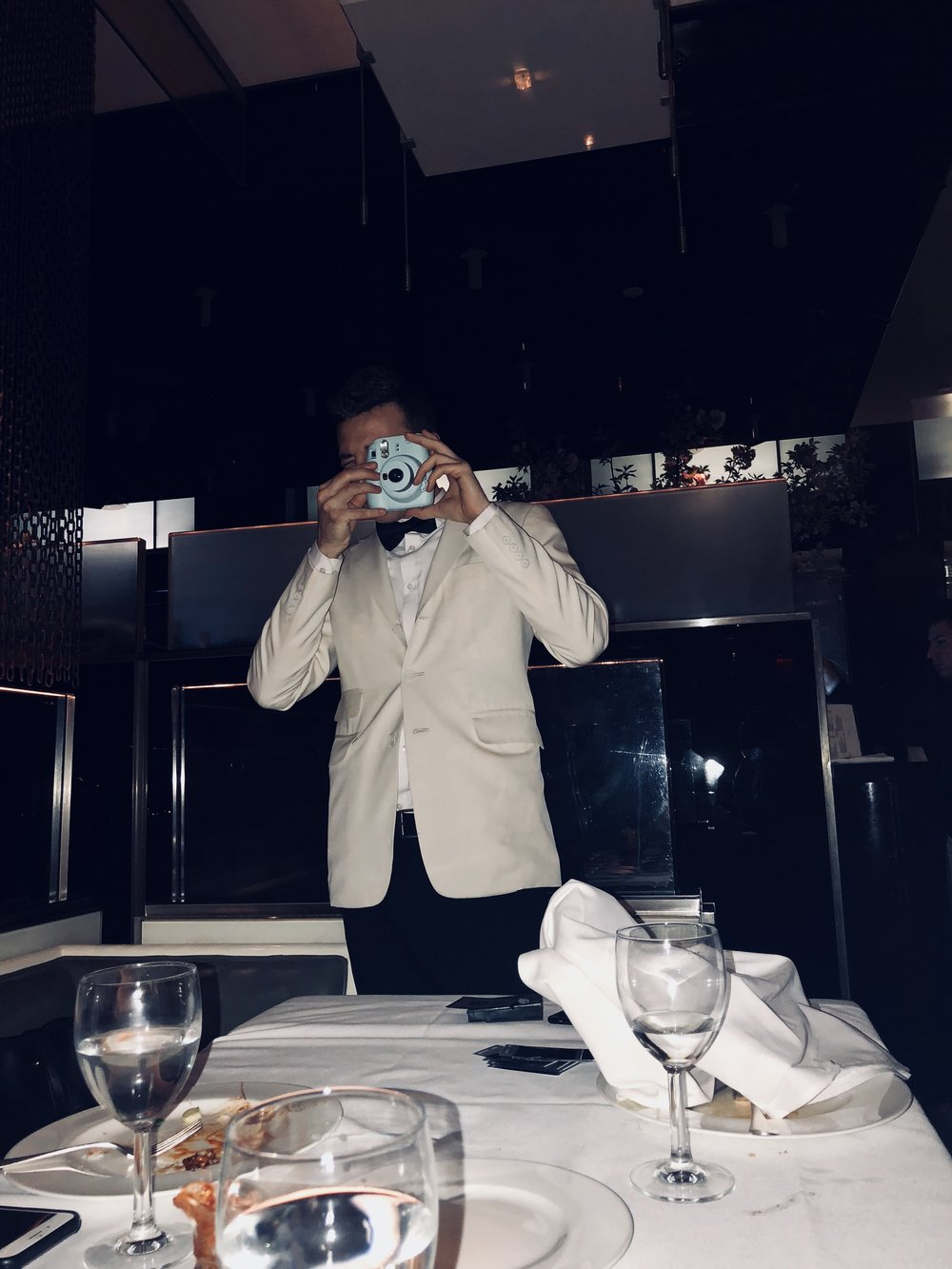 Italian waiter taking a picture  (2018)