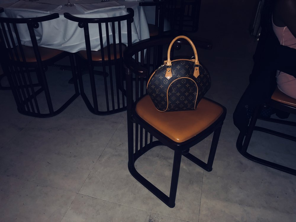Isiuwa's bag on a chair  (2018)