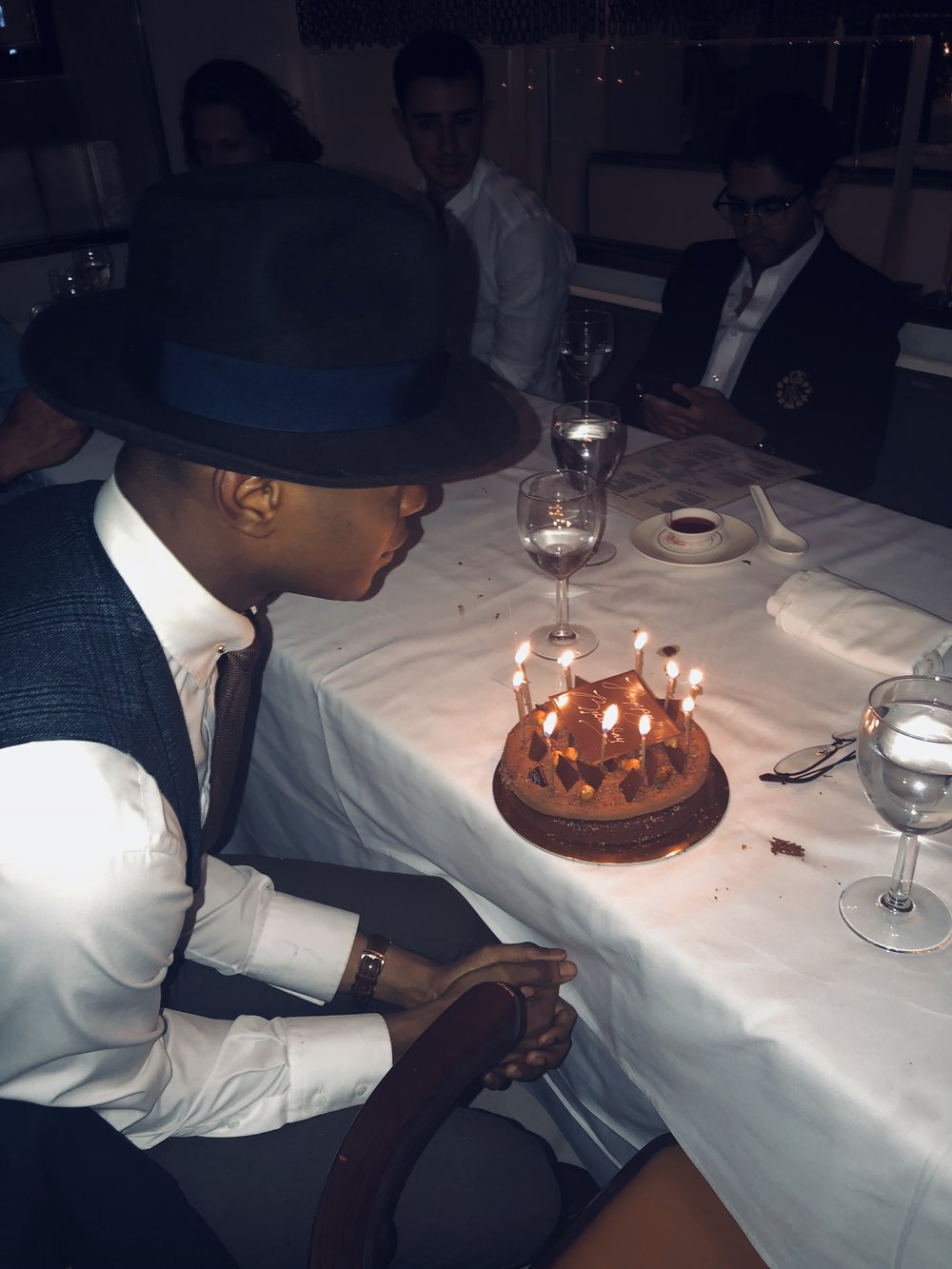 Igwedinma blowing out candles on his 24th birthday  (2018)