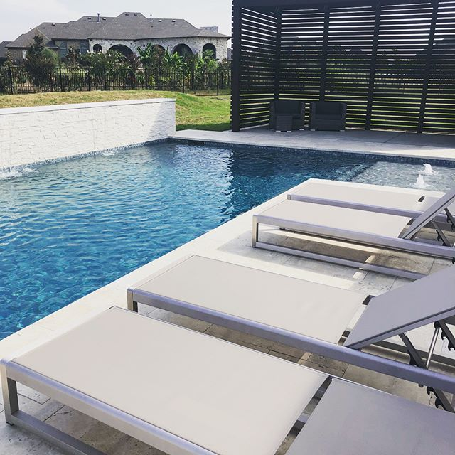 Beautiful clean and sleek pool and outdoor living space we just finished up in Rockwall! Love how the look of pools is going in this direction! #pool #swimmingpool #swimming #texaspools #texaspoolbuilder #swimtime #poollife #poolside #suntan #peacfulplace #poolman #outdoors #outdoorliving #waterfall #pebbletec #pavers #cabanalife #rockwall #rockwallpools #heath #heathtx #forney #forneytx @pebbletec @pentairpool @nobletile