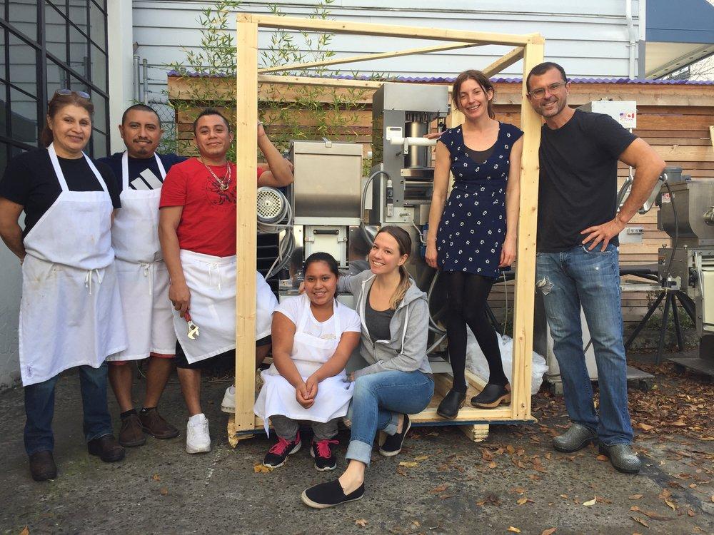 JP team members with their newly arrived pasta/ravioli machine maria, franklin, carlos, marta, mary alice, keema and roland