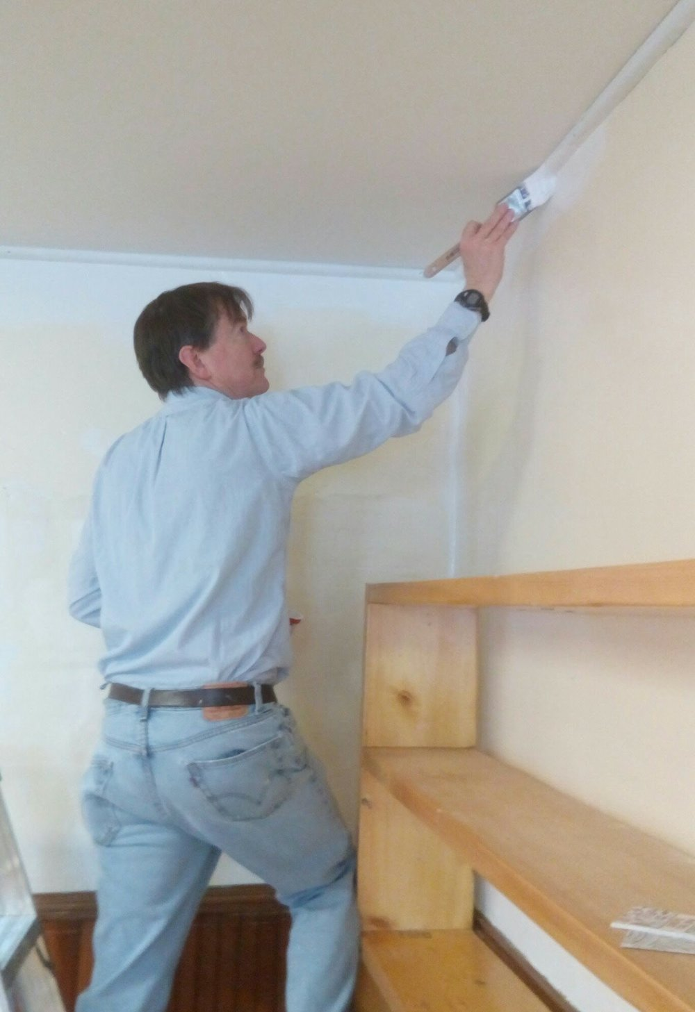 Volunteer rob dewees transforms the library with a coat of fresh paint
