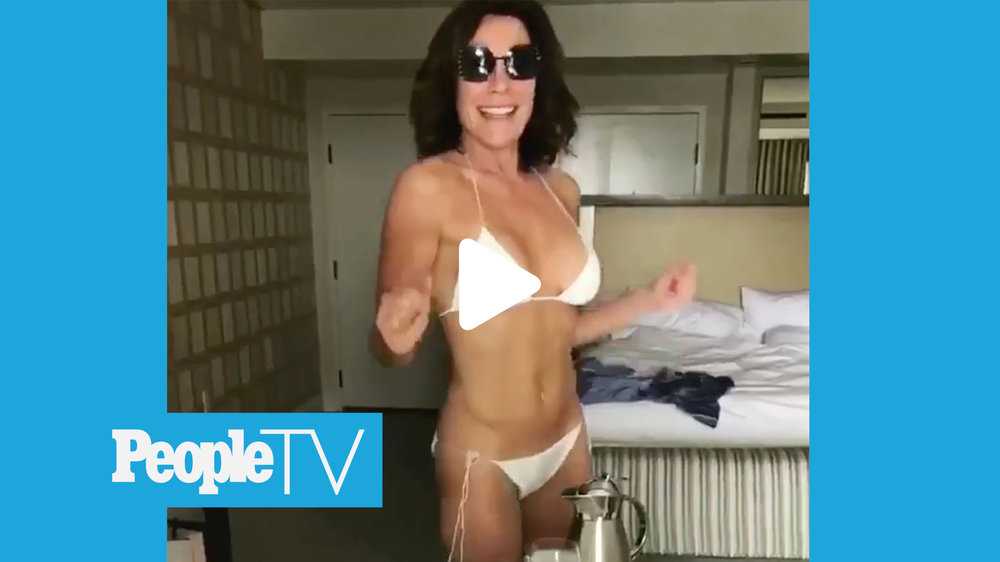 """Luann de Lesseps ' heart may be in New York City, but she sure loves the Southern California sun.  De Lesseps, 52, stripped down to a white-hot string bikini Tuesday, when she shook her fit """" yoga body """" for cameras."""