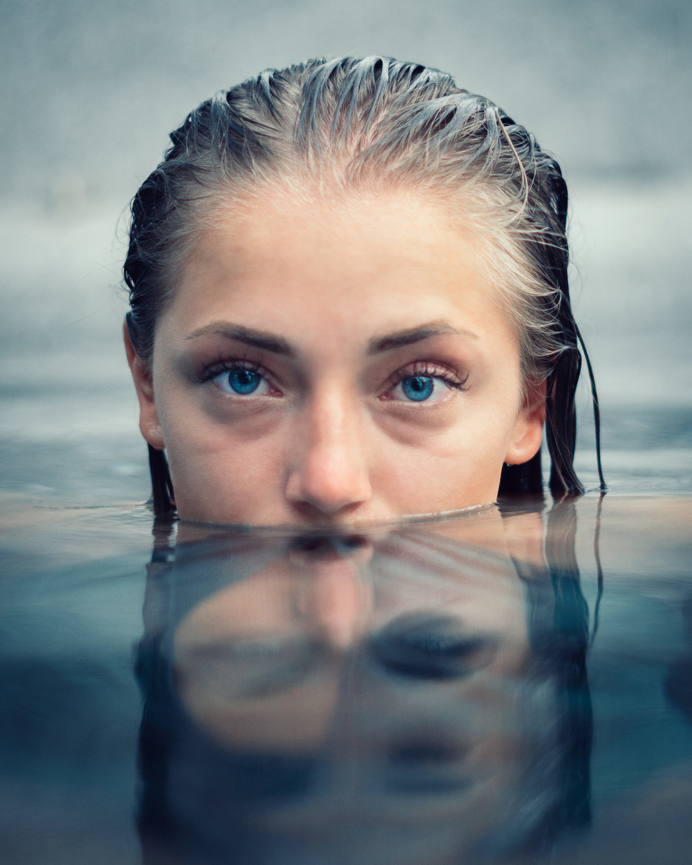 Girl with blue eyes in water