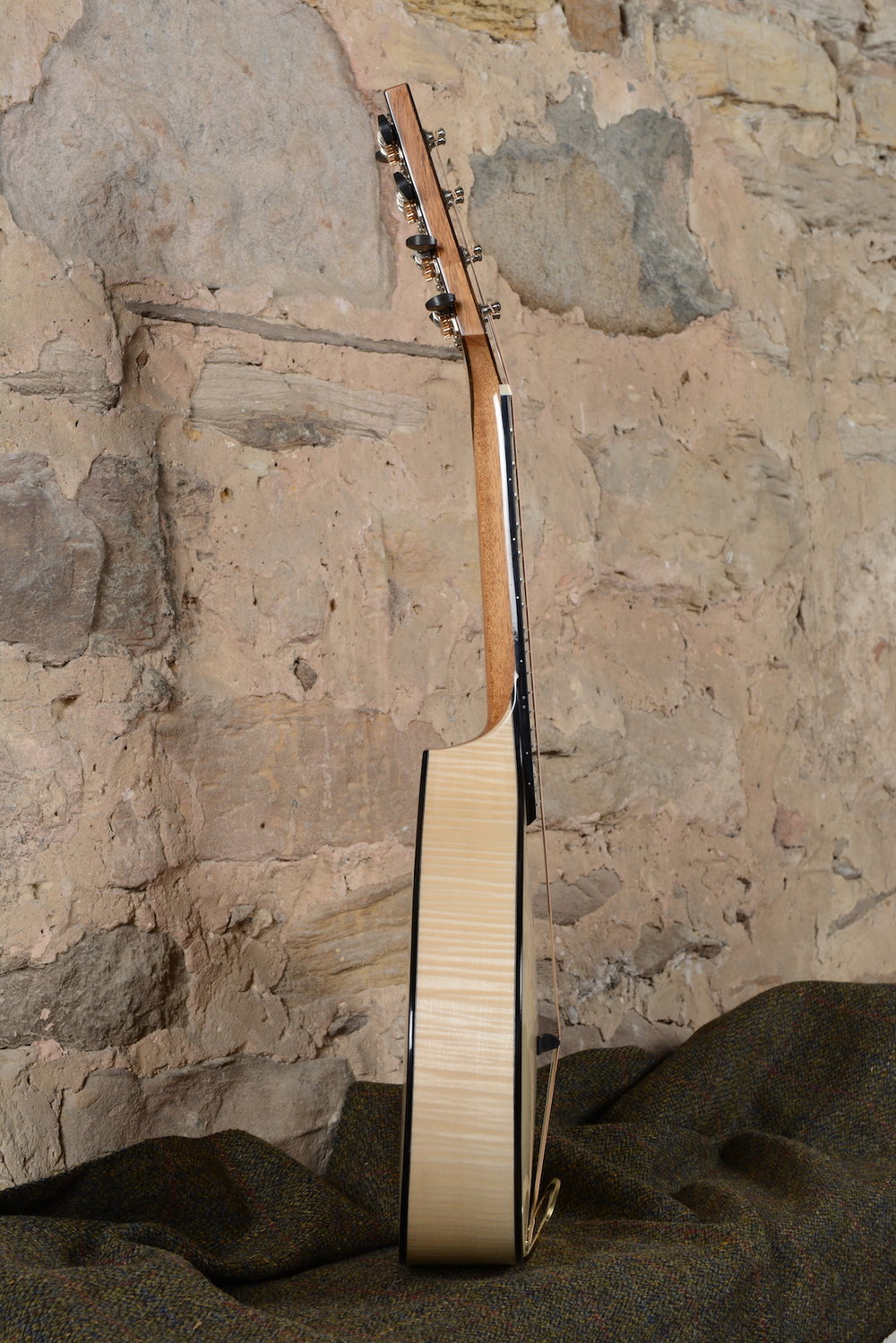 Carved arch-top Swiss Spruce soundboard