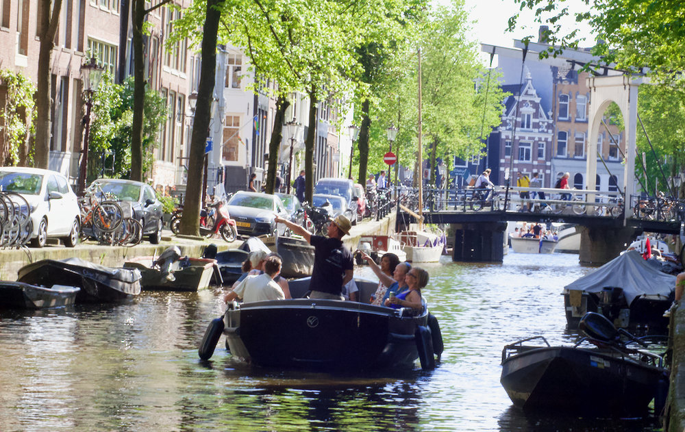 Amsterdam Boat Tour - Join our boat tour and escape the hectic Amsterdam street life while enjoying the relaxed atmosphere on the best canal cruise in town. Don't miss this opportunity to see and experience Amsterdam from this unique and magnificent view.