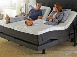 """An example of a split king adjustable base doing what it is designed to do. Independent control and comfort on both sides of the system enable each user to find their perfect """"sweet spot""""..."""