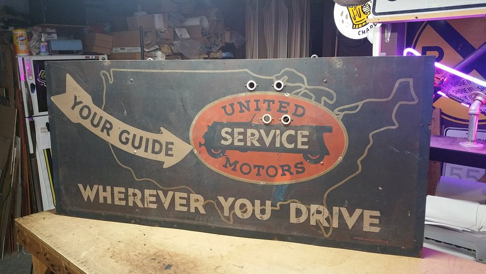 United Service Motors sign before restoration.