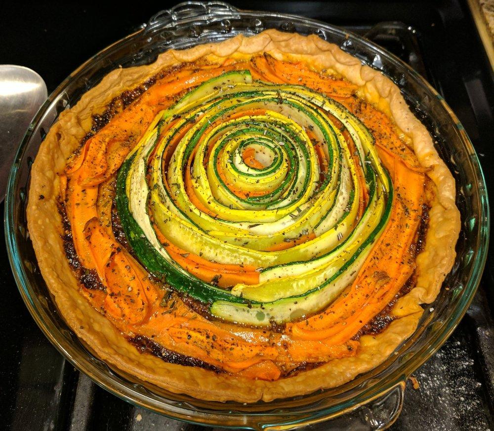 Roasted veggies on tomato pesto on pie crust.