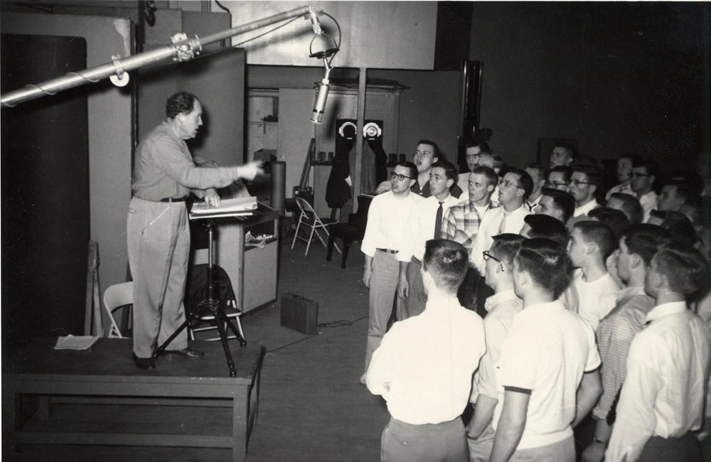 Dr. Duey with the Men's Glee Club in a recording session