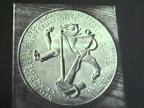 A Llangollen medal awarded to the Men's Glee Club from winning the Eisteddfod Festival in 1978.