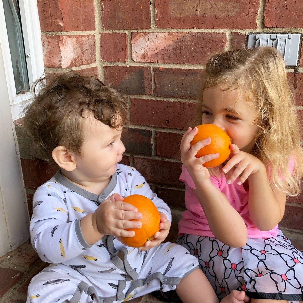 kids with oranges.jpg