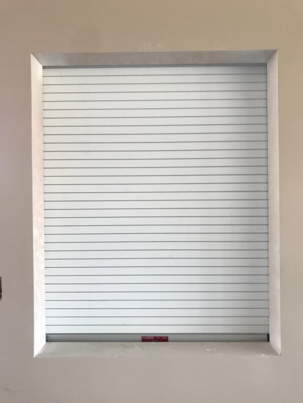 Counter Shutters - Counter Shutter Doors are designed for interior or exterior applications.  Often used in lobbies or as service windows, counter shutters provide maximum security, practical use, and cosmetic design.