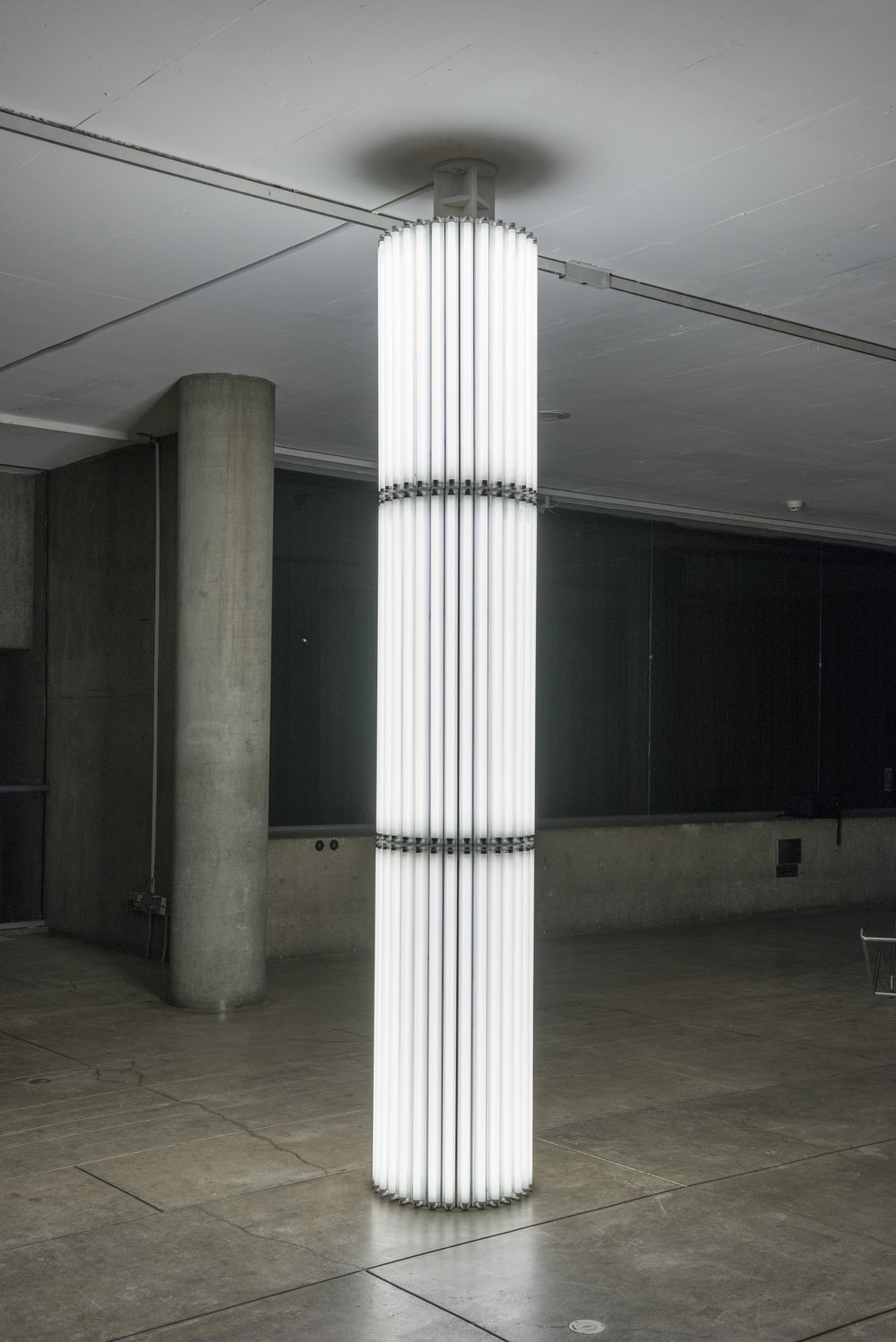 Cerith Wyn Evans,  Untitled (Column), 16 , 2009. Wood, fluorescent tubes, and lamp fixtures. 138 × ø 22 inches. Courtesy White Cube and Carpenter Center for the Visual Arts.