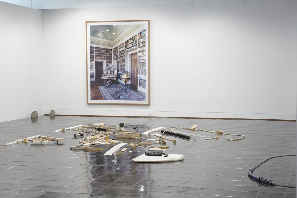 Suzanne Silver,  Kafka in Space (Parsing the Eruv) , 2009. Wood, rubber, wallboard, plaster, metal, rope, canvas, metal leaf, chalk, tape, vinyl, neon, dimensions variable. Courtesy of the artist. Background: Candida Höfer,  Narodni knihovna Praha V , 2004. C-print, 72 x 88 inches. Courtesy of the artist and Rena Bransten Gallery, San Francisco, image courtesy of Candida Höfer/VG Bild-Kunst, Bonn.