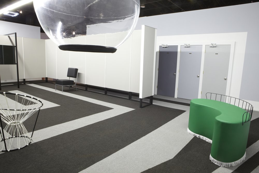 Christian Tomaszewski,  PLAYTIME , 2009. Carpet, clear globe, two sofas, two chairs, one ashtray, one lamp, black mirror, fabric screen, three doors and sound (40 minutes), 950 square feet. Courtesy of the artist.