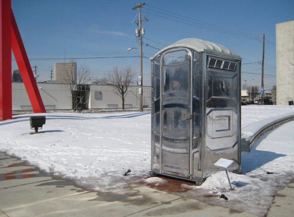 Patrick Killoran,  Glass Outhouse , 2002-ongoing; unlimited edition of port-a-potty, 91 x 43.5 x 47 inches; courtesy of the artist