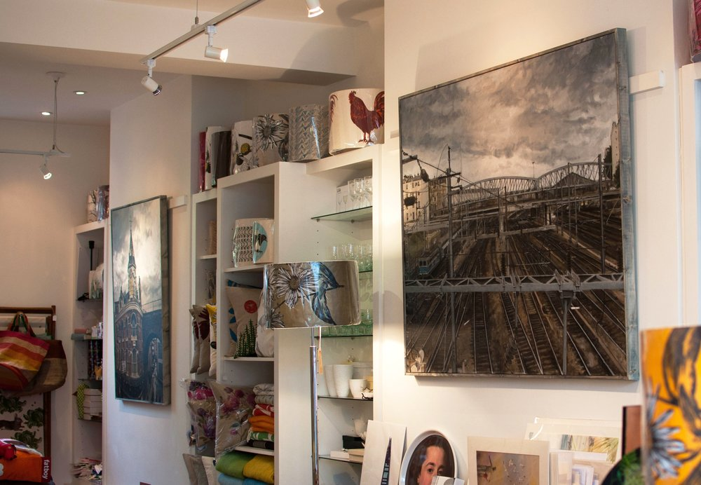 Upper gallery space featuring 'Conductors' and 'Brixton Clocktower'
