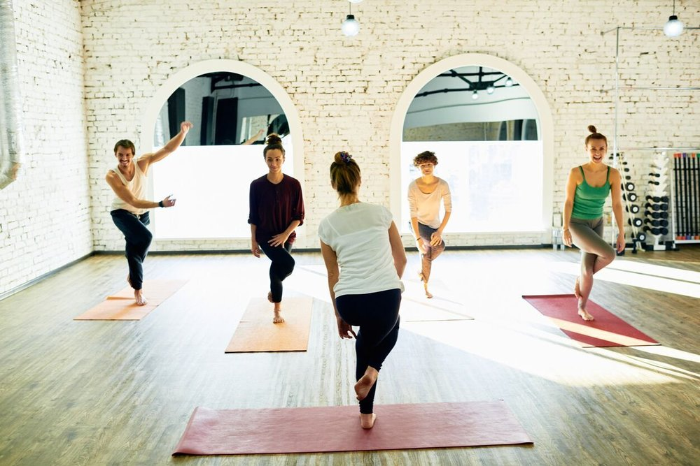 Students-learning-new-yoga-pose-854061644_1256x838_preview.jpeg