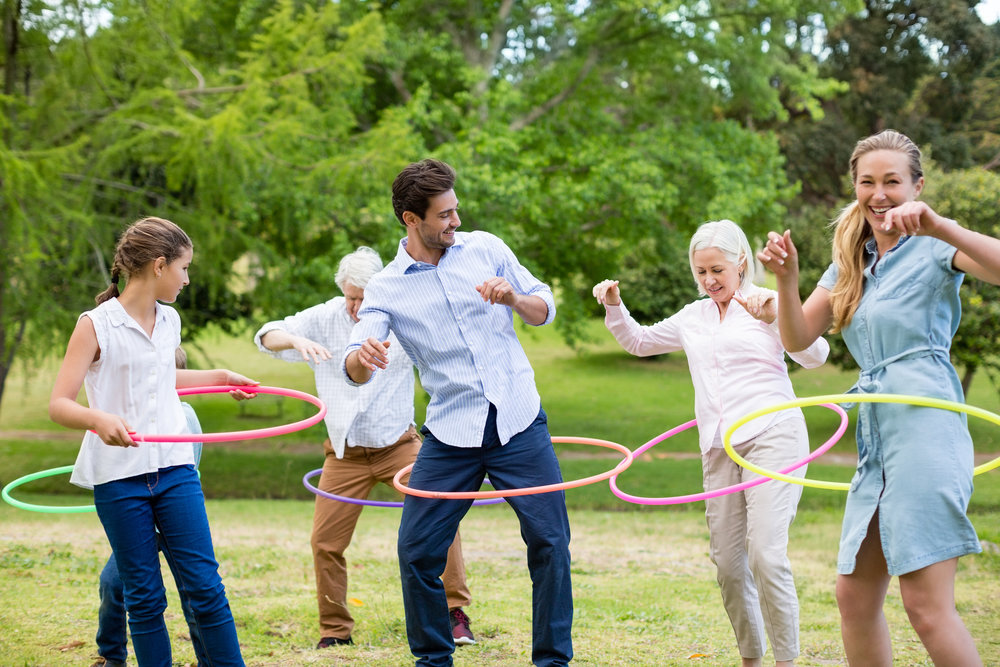 Multi-generation-family-playing-with-hula-hoop-656349580_2125x1416.jpeg