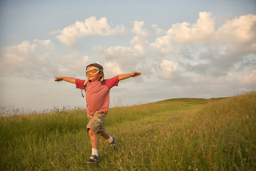 Young-English-Boy-Imagines-Flying-on-Hill-481258993_2125x1416.jpeg