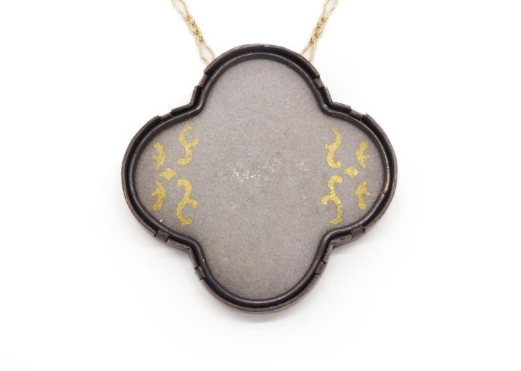 """Cement Quatrefoil , copper, enamel, 24k gold foil, 24k gold filled chain, 2"""" x 2"""" (24"""" chain), 2015 (photo by artist)"""