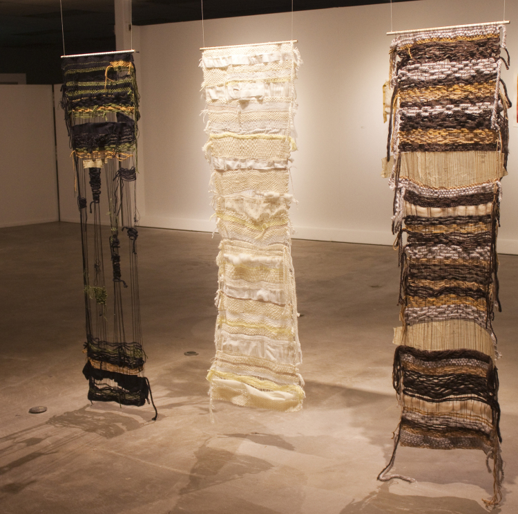 "I Hope That's all I Got, Hinton Waist  and  You Look Better With Your Hair Down  (left to right), yarn, fabric, dress patterns, 65"" x 20"" x 2"", 2015 (photo by artist)"