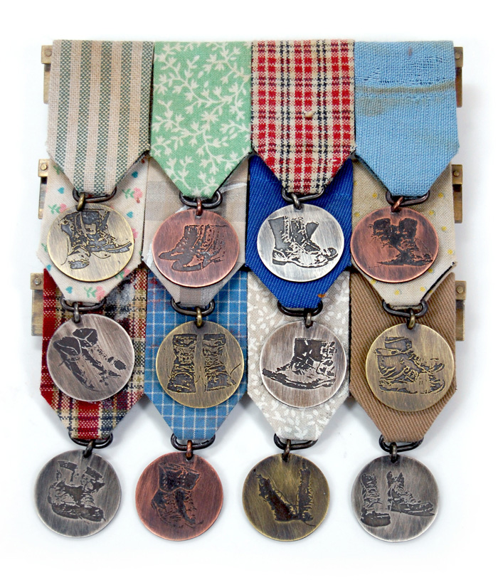 "Blue Collar Medal,  used clothing, brass, copper, nickel silver, stainless steel, 5"" x 4¼"" x ½"", 2012"